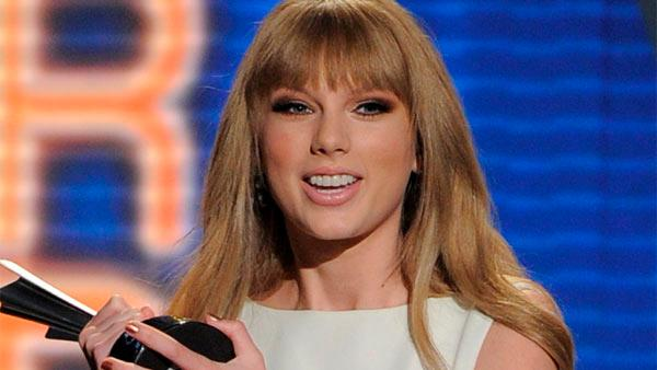 Taylor Swift accepts the award for Entertainer of the Year at the 47th Annual Academy of Country Music Awards on Sunday, April 1, 2012 in Las Vegas. - Provided courtesy of AP / Mark J. Terrill