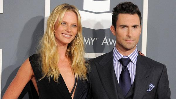 Anne V, left, and Adam Levine arrives at the 54th annual Grammy Awards on Sunday, Feb. 12, 2012 in Los Angeles.