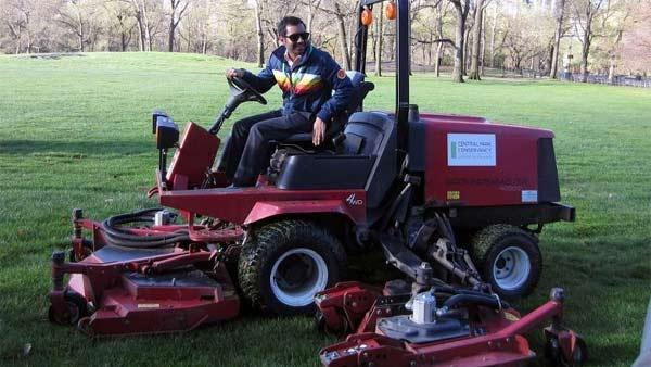 Aziz Ansari mows the lawn at New York Citys Central Park, as seen in this photo released by the Central Park Conservancy on April 2, 2012. - Provided courtesy of Central Park Conservancy