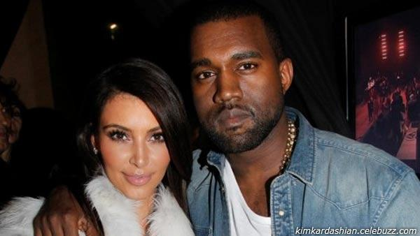Kim Kardashian and Kanye West appear in a photo from Wests fashion show in Paris on March 7, 2012. - Provided courtesy of kimkardashian.celebuzz.com
