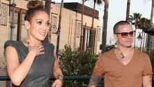 Jennifer Lopez and boyfriend Casper Smart attend the grand opening of restaurant Planet Dailies and lounge Mixology 101 in Los Angeles on April 5, 2012. The event included a screening of the American Idol judges new music video, Dance Again. - Provided courtesy of Christopher Polk / Getty Images