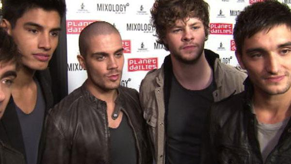 Nathan Sykes, Siva Kaneswaran, Max George, Jay McGuiness and Tom Parker, members of the boy band the Wanted, talk to OnTheRedCarpet.com at the opening of restaurant Planet Dailies and its