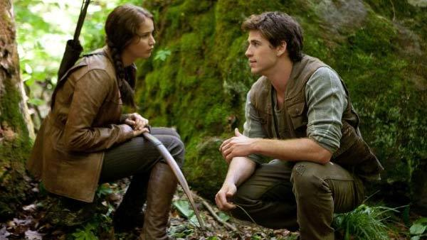 Jennifer Lawrence and Liam Hemsworth appear in a scene from The Hunger Games. - Provided courtesy of OTRC / Lionsgate
