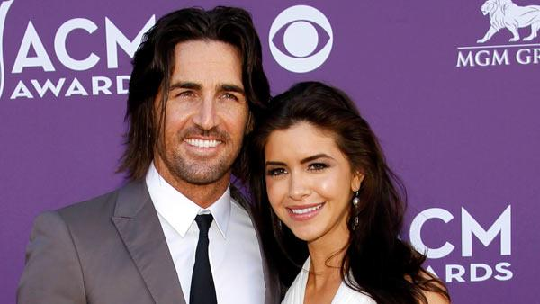 Jake Owen, left, and Lacey Buchanan arrive at the 47th Annual Academy of Country Music Awards on Sunday, April 1, 2012 in Las Vegas. - Provided courtesy of AP / Isaac Brekken