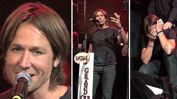 Keith Urban is surprised on stage at the All For The Hall benefit concert at Bridgestone Arena on April 10, 2012 with a microphone stand symbolizing his invitation to join the Grand Ole Opry. - Provided courtesy of Grand Ole Opry / youtube.com/user/oprylive