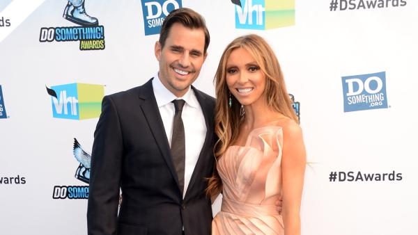 E! host Giuliana Rancic and husband Bill Rancic arrive at the 2012 Do Something Awards at Barker Hangar on August 19, 2012 in Santa Monica, California.
