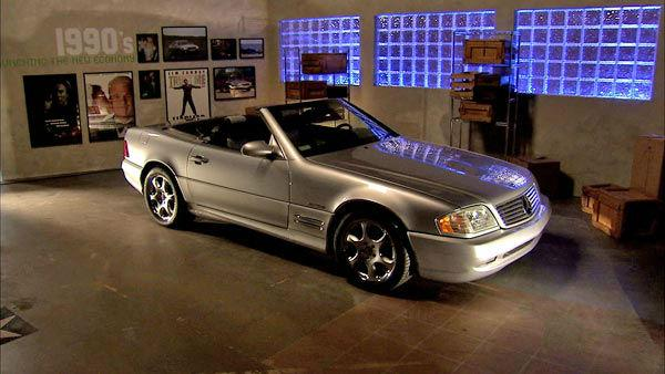 This 2002 SL500 Roadster Silver Arrow, photographed at a 2012 exhibit at the Warner Brothers Studios showcasing Mercedes-Benz automobiles featured in the movies.