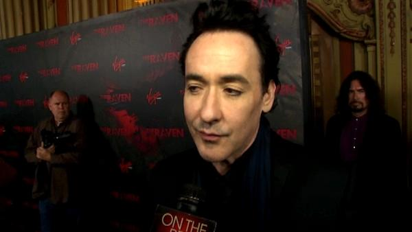 John Cusack talks to OnTheRedCarpet.com at the Los Angeles premiere of The Raven on April 23, 2012. - Provided courtesy of OTRC