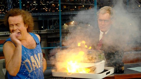 In this photo released by CBS, author and fitness personality Richard Simmons, left, reacts to an explosion under the vegetable steamer as host David Letterman watches on the Late Show with David Letterman Wednesday, Nov. 29, 2006 in New York. - Provided courtesy of AP Photo/CBS, J.P. Filo