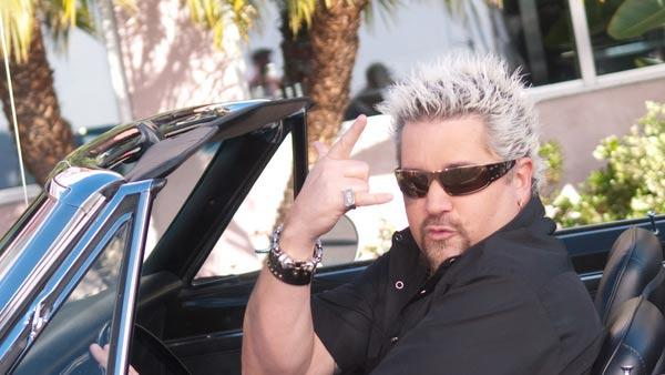 Guy Fieri appears in a promotional photo for the Food Network series Diners, Drive-ins and Dives. - Provided courtesy of Food Network