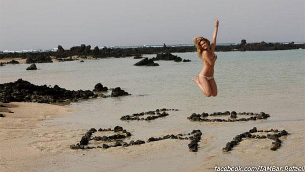 Bar Refaeli jumps topless on a beach in Lanzarote in Spains Canary Islands, during a photo shoot for ELLE Spain in April 2012. She posted the picture on her Facebook page on May 1, 2012. - Provided courtesy of facebook.com/IAMBar.Refaeli