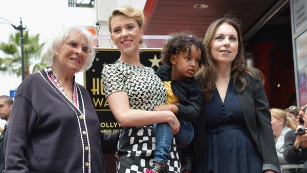 Scarlett Johansson poses with her grandmother, Dorothy, adopted sister, Fenan, and mother, Melanie, as she receives a star on the Hollywood Walk of Fame on May 2, 2012, two days before the release of her new film, The Avengers. - Provided courtesy of Walt Disney Studios Publicity