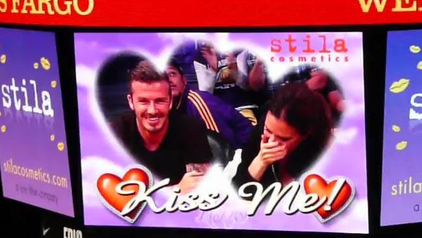 David Beckham and his wife Victoria are caught on kiss cam as they watch an NBA first-round playoff basketball game between the Los Angeles Lakers and the Denver Nuggets at Staples Center in Los Angeles on May 1, 2012.