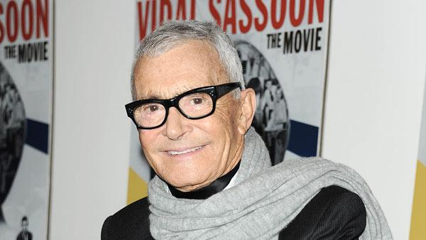 In this photo released by Starpix, hair designer and businessman, Vidal Sassoon, stops for a photo at a special screening of `Vidal Sassoon: The Movie,
