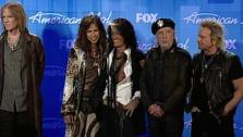 American Idol judge Steven Tyler stands with his Aerosmith band mates and talks to reporters backstage after the American Idol finale in Los Angeles on May 23, 2012. - Provided courtesy of OTRC