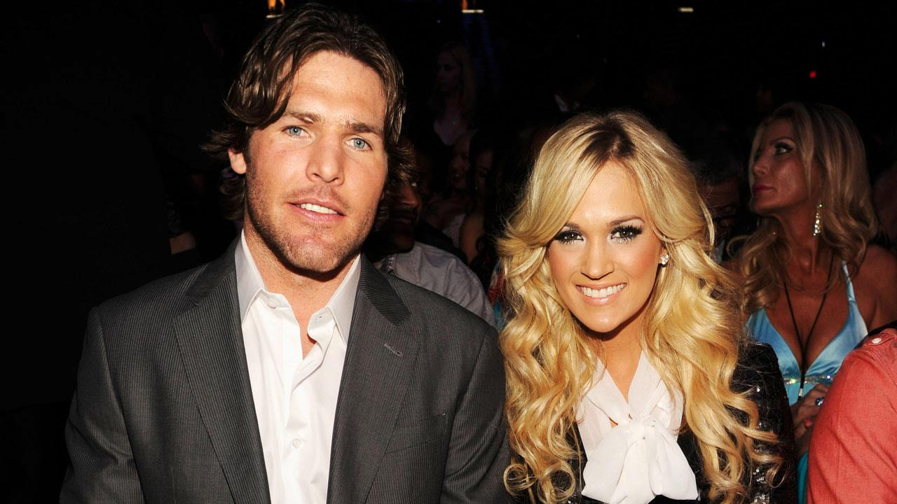 Carrie Underwood and husband Mike Fisher appear at the Billboard Music Awards in May 2012.
