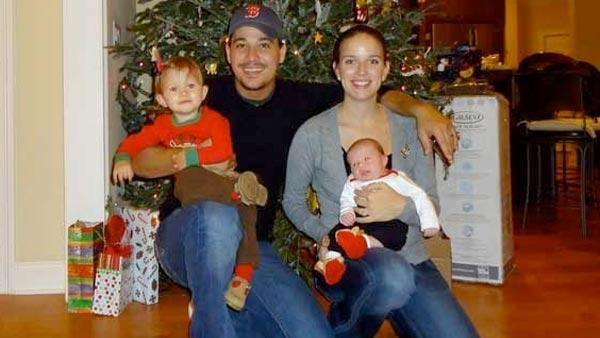 Rob Mariano, aka Boston Rob, is pictured with wife and fellow 'Survivor' alum Amber and their daughters Lucia Rose and Carina Rose in this photo posted on his website in December 2010.