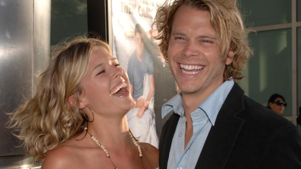 Cast member Eric Christian Olsen, right, and Sarah Wright, left, attend the premiere of 'License to Wed' Monday, June 25, 2007, in the Hollywood section of Los Angeles.
