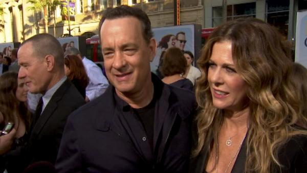Tom Hanks dishes on working with George Takei and Julia Roberts on 'Larry Crowne' and his scooter fashion.
