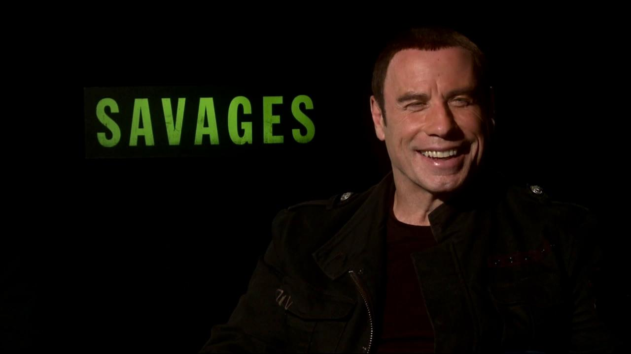 John Travolta talks to OnTheRedCarpet.com at the premiere of Oliver Stones film Savages in Los Angeles on June 25, 2012.