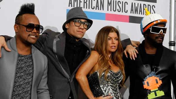 The Black Eyed Peas thank fans backstage at the 2010 American Music Awards in Los Angeles.