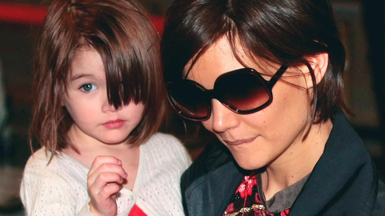 Katie Holmes and daughter Suri Cruise arrive at Narita International Airport in Narita, east of Tokyo, Sunday, March 8, 2009.