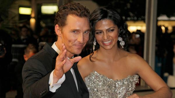 Actor Matthew McConaughey, left, and  Camilla Alves depart after the screening of Mud at the 65th international film festival, in Cannes, southern France, Saturday, May 26, 2012.