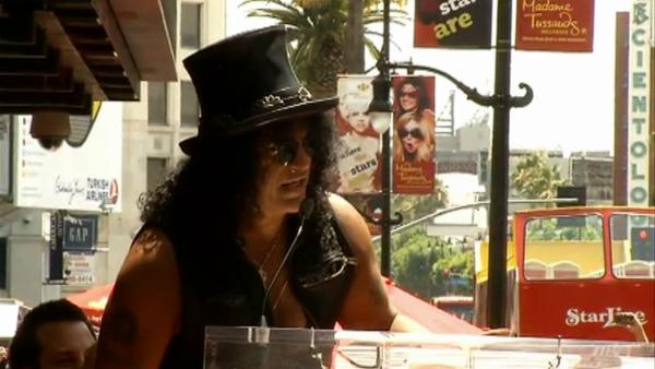 Slash talks about Hollywood past at star ceremony