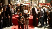 Slash poses with his wife and kids on his new Hollywood star on July 10, 2012. - Provided courtesy of OTRC