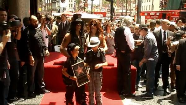 Slash with kids, Guns N' Roses alums at star ceremony
