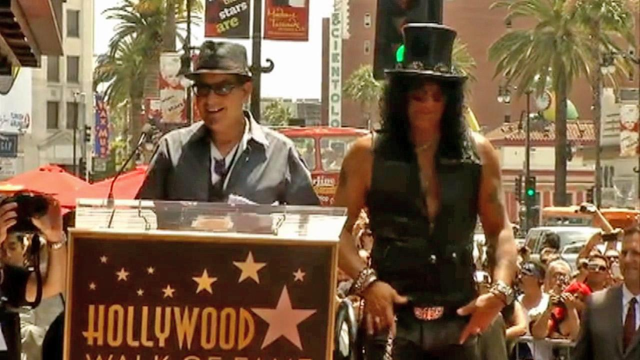 Slash appears with Charlie Sheen before receiving a star on the Hollywood Walk of Fame on July 10, 2012.