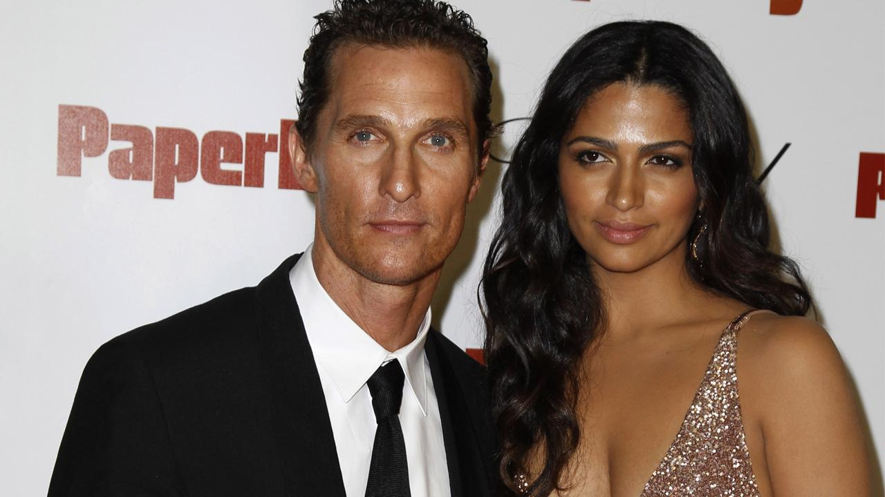 Matthew McConaughey arrives with Camila Alves for a party to celebrate Paperboy at the Carlton beach in Cannes, France on May 24, 2012.