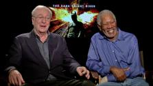 Michael Caine and Morgan Freeman talk to OnTheRedCarpet.com about The Dark Knight Rises in a junket interview on July 9, 2012. - Provided courtesy of OTRC