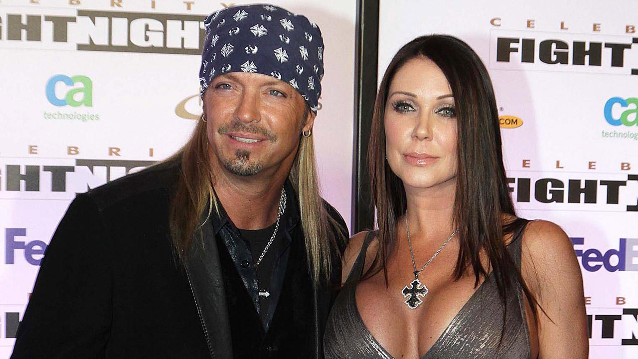 This March 19, 2011 file photo shows singer Bret Michaels and his girlfriend Kristi Gibson at Muhammad Ali Celebrity Fight Night XVII in Phoenix.