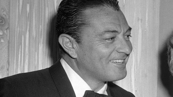 Tony Martin appears in a photo from the testimonial dinner for Jack Benny by the Friars Club in Hollywood, Los Angeles on February 14, 1957.