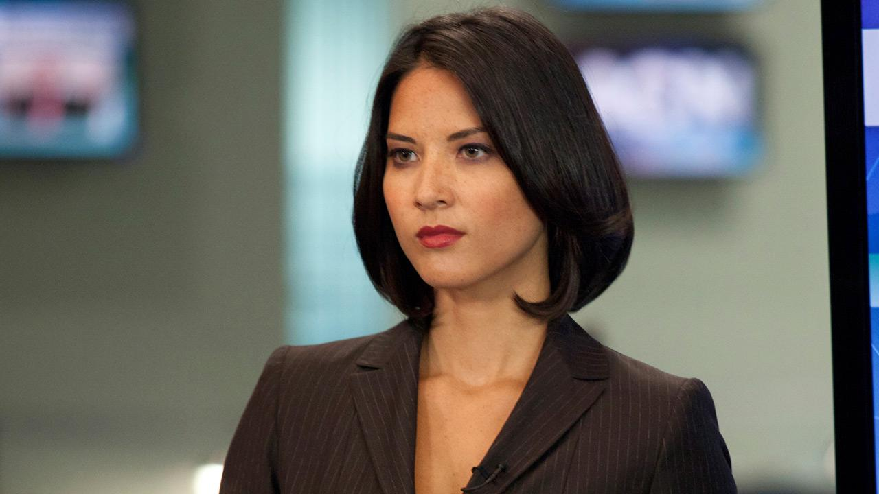 Olivia Munn appears in a scene from a 2012 episode of The Newsroom.