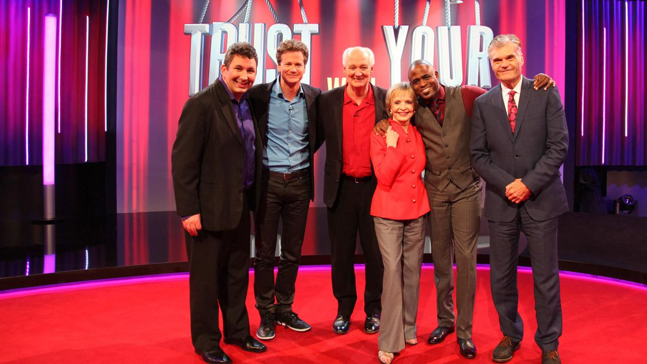 L-R: Craig Cackowski, Jonathan Magnum, Colin Mochrie, Florence Henderson, Wayne Brady and Fred Willard appear in a promotional photo for the ABC improv comedy series Trust Us With Your Life. Henderson appeared in an episode that aired on July 24, 2012.