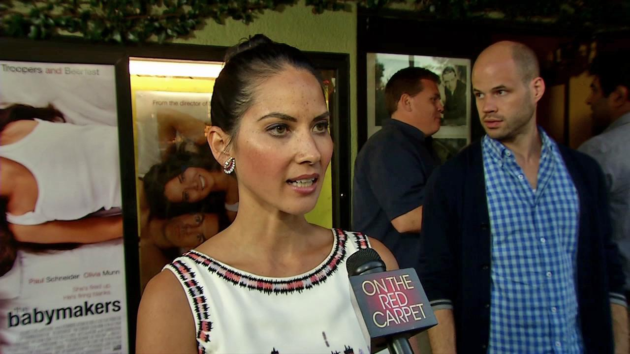 Olivia Munn talks to OnTheRedCarpet.com at the Los Angeles premiere of Babymakers on July 25, 2012.