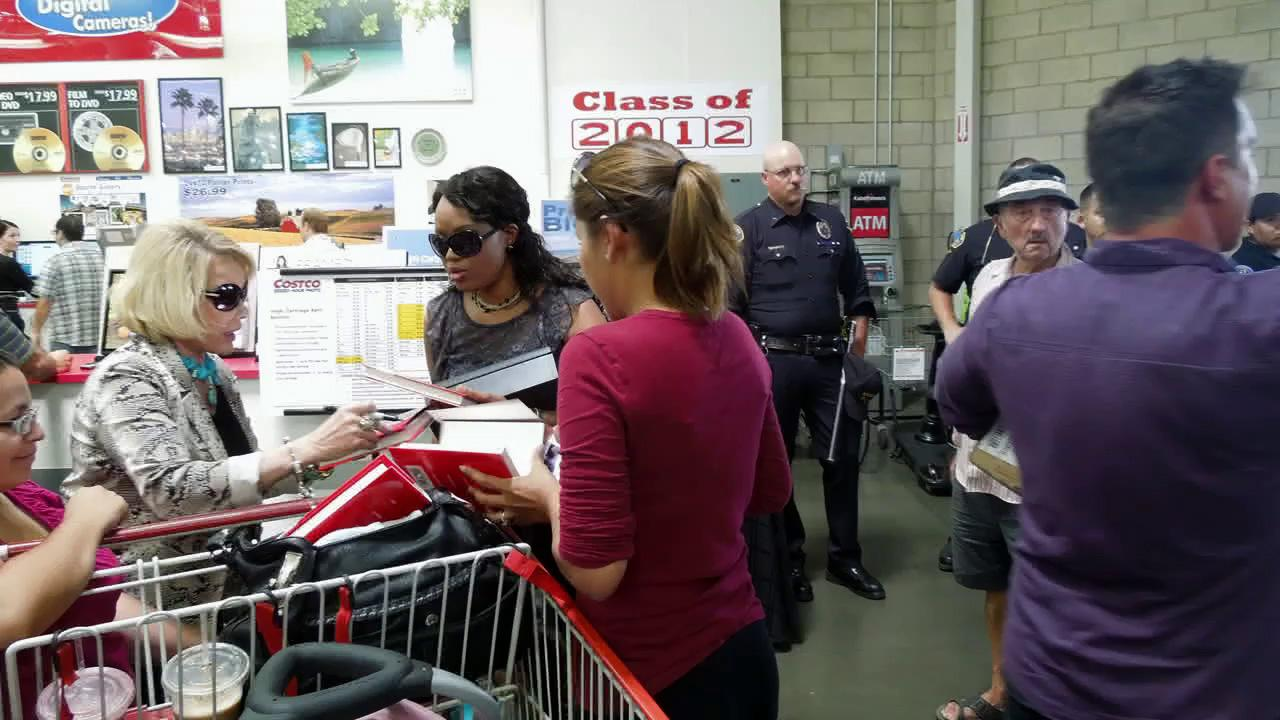 Joan Rivers signs copies of her new book at a Costco in Burbank, California, on Aug. 7, 2012. The comedienne says the wholesale store has banned the product because it contains explicit language.