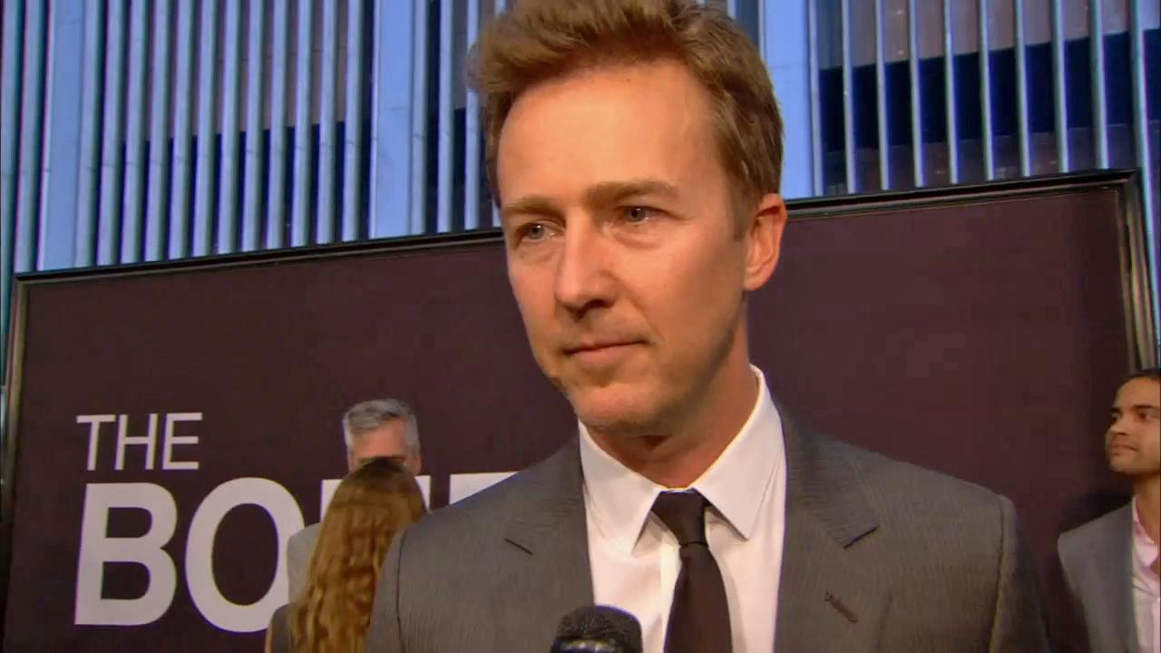 Edward Norton talks to reporters at the August 8 premiere of The Bourne Legacy.