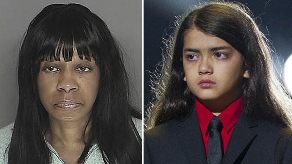Billie Jean Jackson appears in a March 2008 booking photo courtesy of the Santa Barbara County Sherrifs office. / Prince Michael II Blanket Jackson appears at the Michael Forever the Tribute Concert in Cardiff, Wales, Saturday, Oct. 8, 2011. - Provided courtesy of Santa Barbara County Sherrifs Office / AP / Joel Ryan