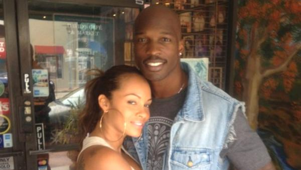 Chad Johnson and his wife, Evelyn Lozada, pose for a picture in this undated file photo posted on his website, ochocinco.com. - Provided courtesy of ochocinco.com
