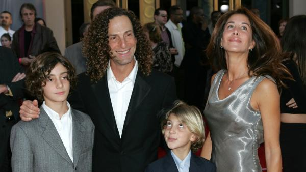Kenny G, second from left, Lyndie Benson, right, Max, left, and Noah arrive for the 32nd annual American Music Awards, Sunday, Nov. 14, 2004, at the Shrine Auditorium in Los Angeles.