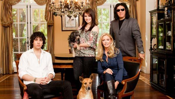 Gene Simmons, Shannon Tweed and their children Nick and Sophie and their dogs pose for an undated promotional photo for the show Gene Simmons Family Jewels. - Provided courtesy of AE Networks