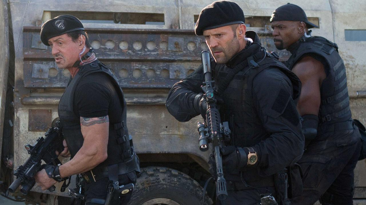 Sylvester Stallone, Jason Statham and Terry Crews appear in a scene from the 2012 movie The Expendables 2.