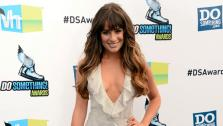 Glee stars Lea Michele poses for photographers at the Do! Something Awards on Aug. 19, 2012. - Provided courtesy of Jason Merritt / Getty Images