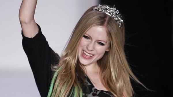 Avril Lavigne cheers as she walks down the runway of her own New York Fashion Week show, where she debuted her Abbey Dawn Spring/Summer 2012 collection, on Monday, Sept. 12, 2011.