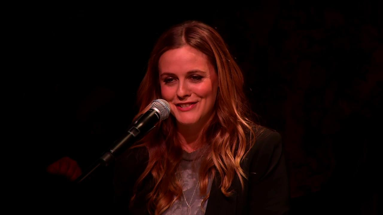 Alicia Silverstone speaks at Alanis Morissettes induction ceremony at the Guitar Centers Hollywood RockWalk on Aug. 21, 2012.OTRC