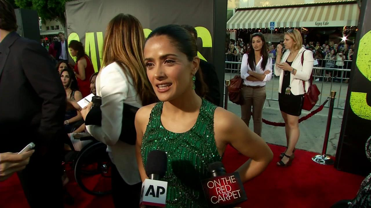 Salma Hayek talks to OnTheRedCarpet.com at the premiere of Oliver Stones film Savages in Los Angeles on June 25, 2012.