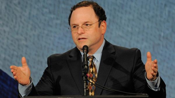 Jason Alexander addresses the crowd before an onstage discussion between Israeli President Shimon Peres and journalist Campbell Brown at the Beverly Hilton Hotel in Beverly Hills, California on Thursday, March 8, 2012.